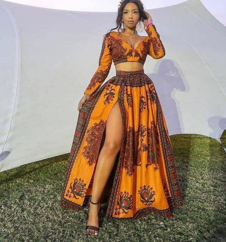 lady wearing ankara crop top with matching flare skirt with slit