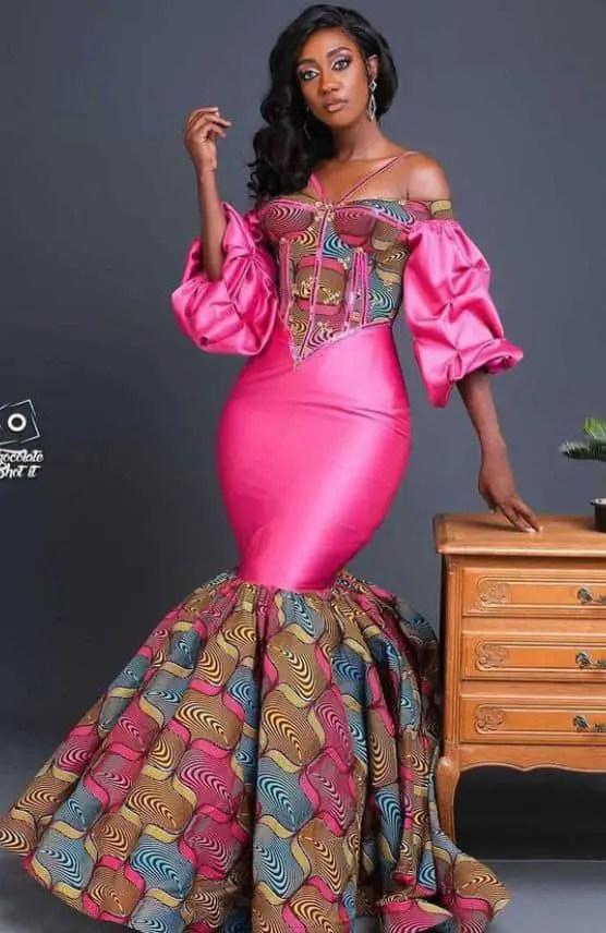 lady wearing long ankara/pink plain material dress