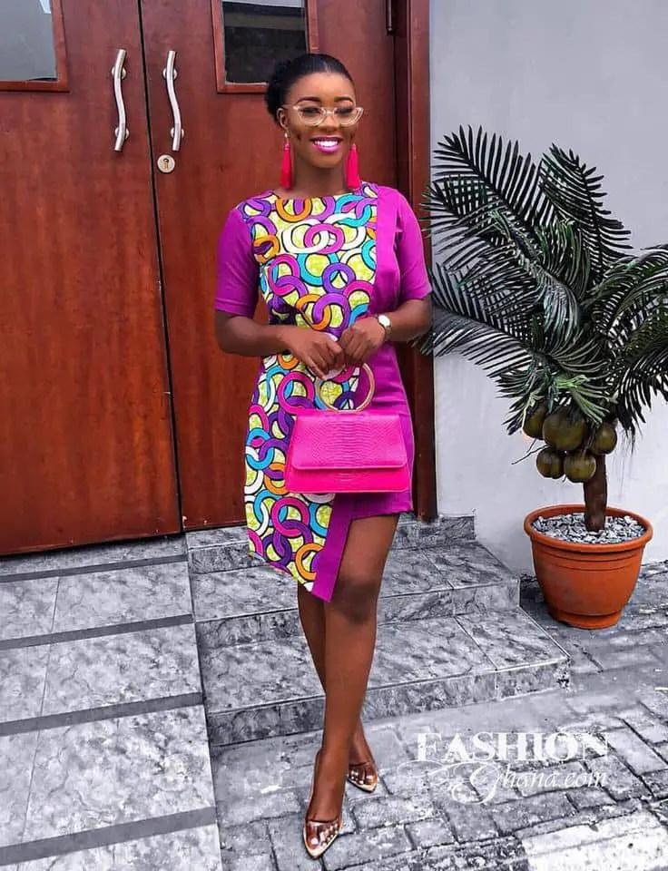 smiling lady wearing ankara/pink plain material dress