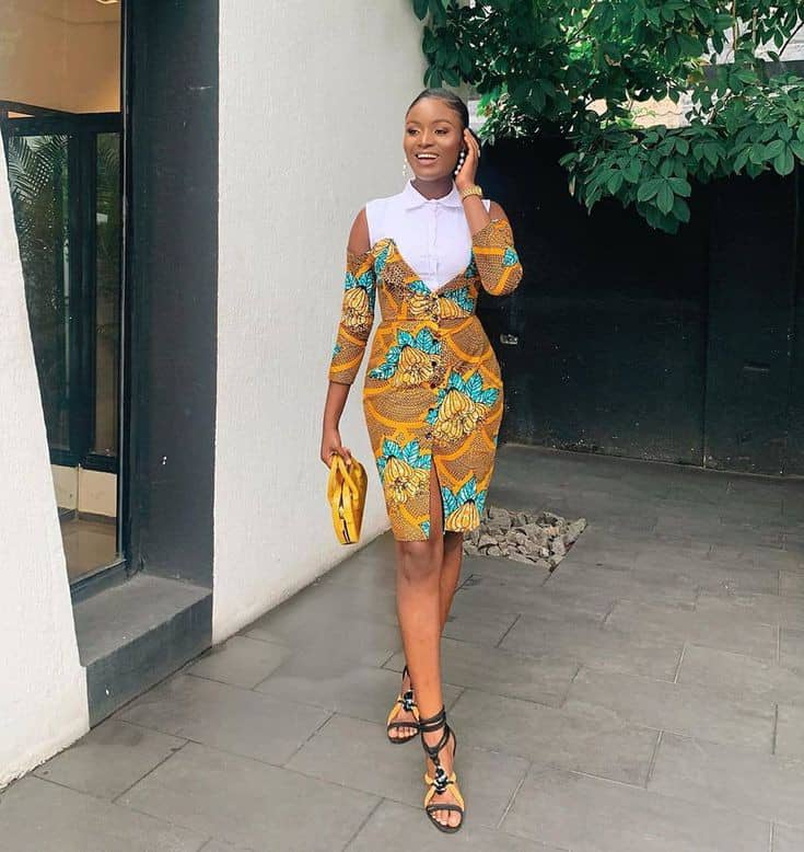 lady wearing ankara dress with a touch of white plain material