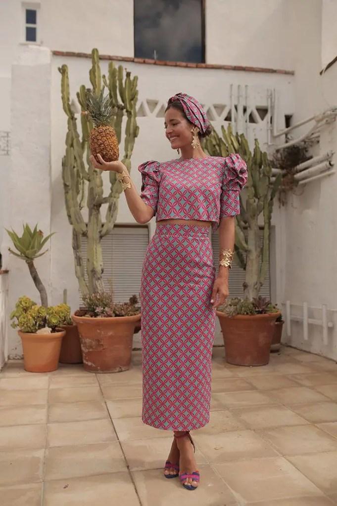 lady wearing ankara top with matching long skirt