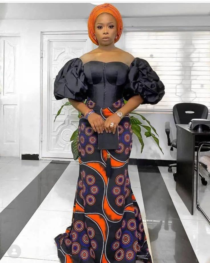 lady wearing black lace/ankara long dress
