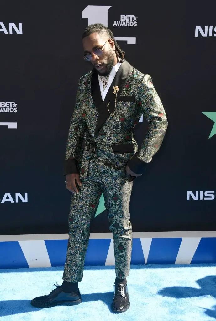 Burna Booy wearing animal print suit