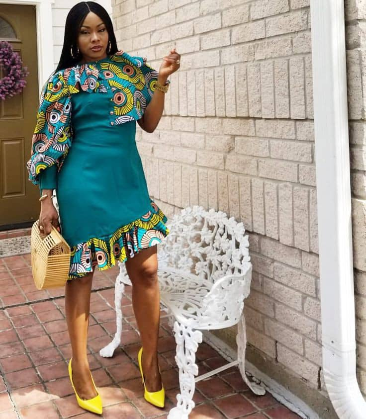 lady wearing plain greenn material dress with a touch of ankara\