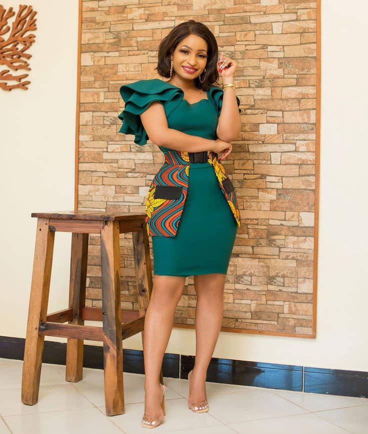 smiling lady wearing green plain material dress with a touch of ankara