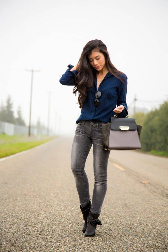 lady wearing shirt and jeans and heels