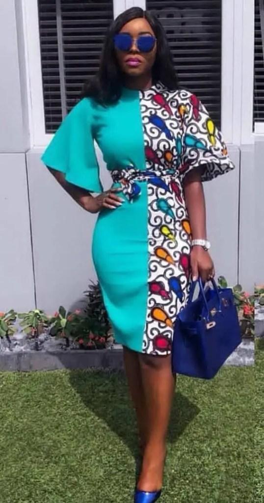 lady wearing plain material/ankara dress