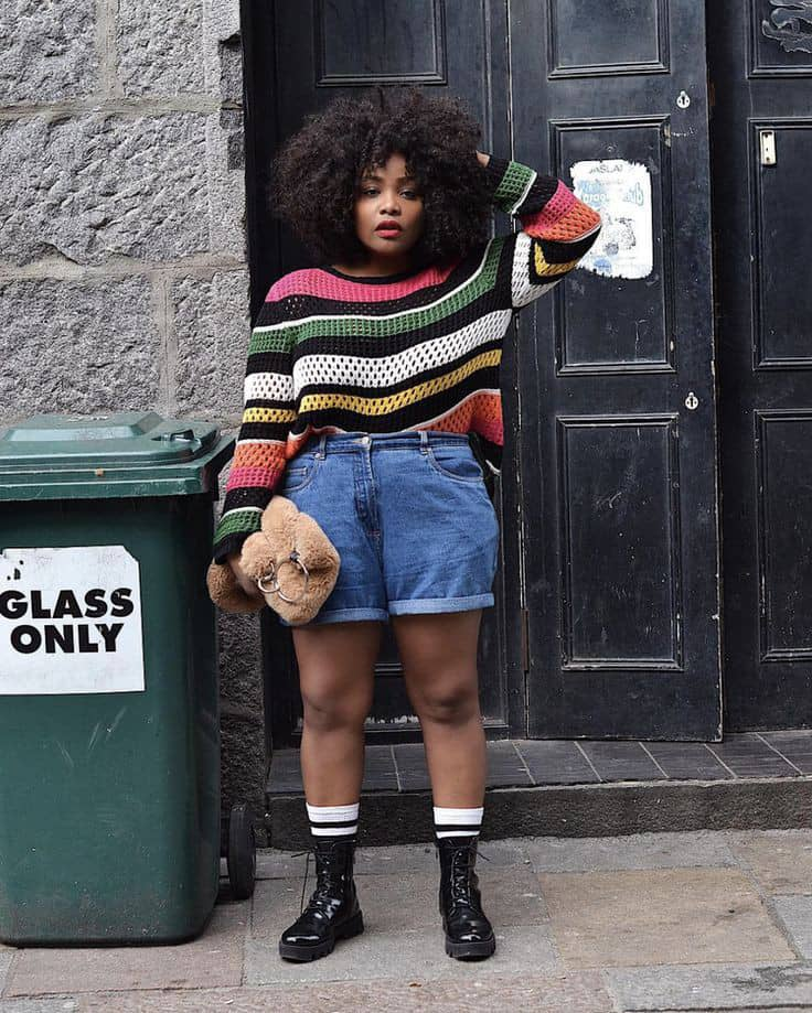 lady wearing sweater, jean shorts and boots