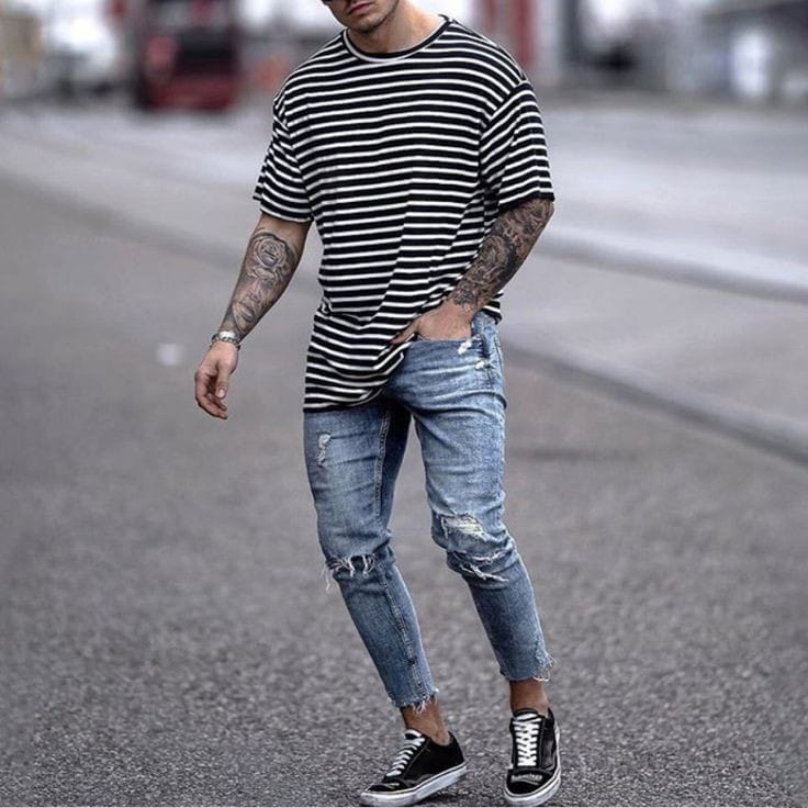 man wearing T-shirt with ripped jeans