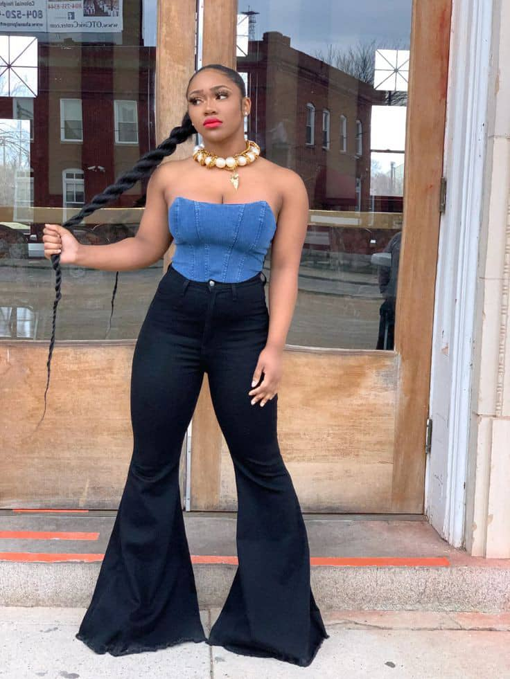 lady wearing blue top with black bell bottoms jeans