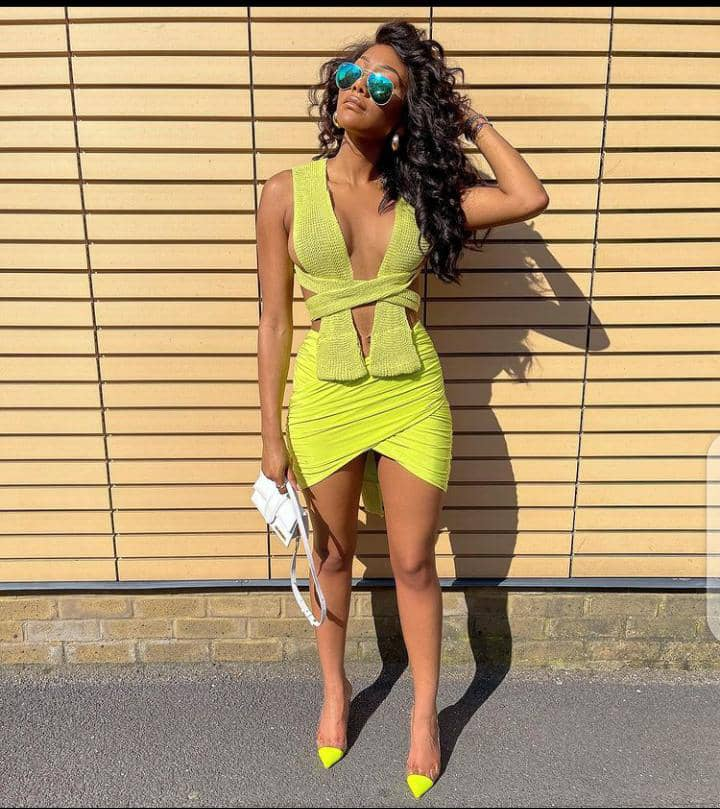 lady wearing yellow outfit with yellow heels