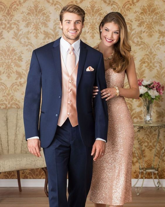 white couple wearing suit and gown