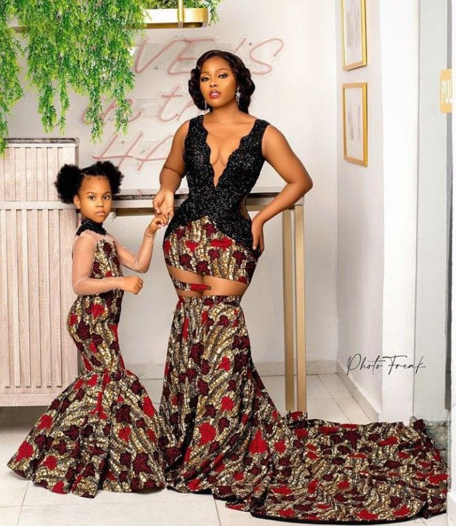 mother and daughter wearing matching ankara dresses