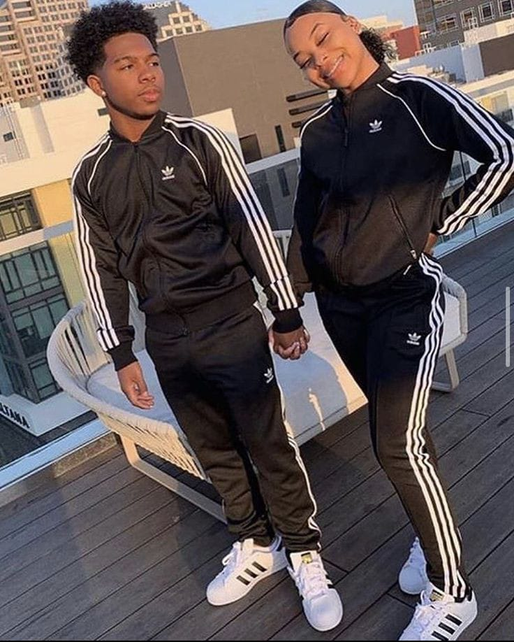 couple wearing matching Adidas outfit