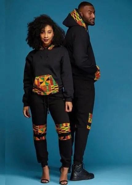 young couple wearing Afro-urban black hoodies