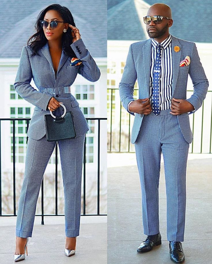 power couple wearing matching suits