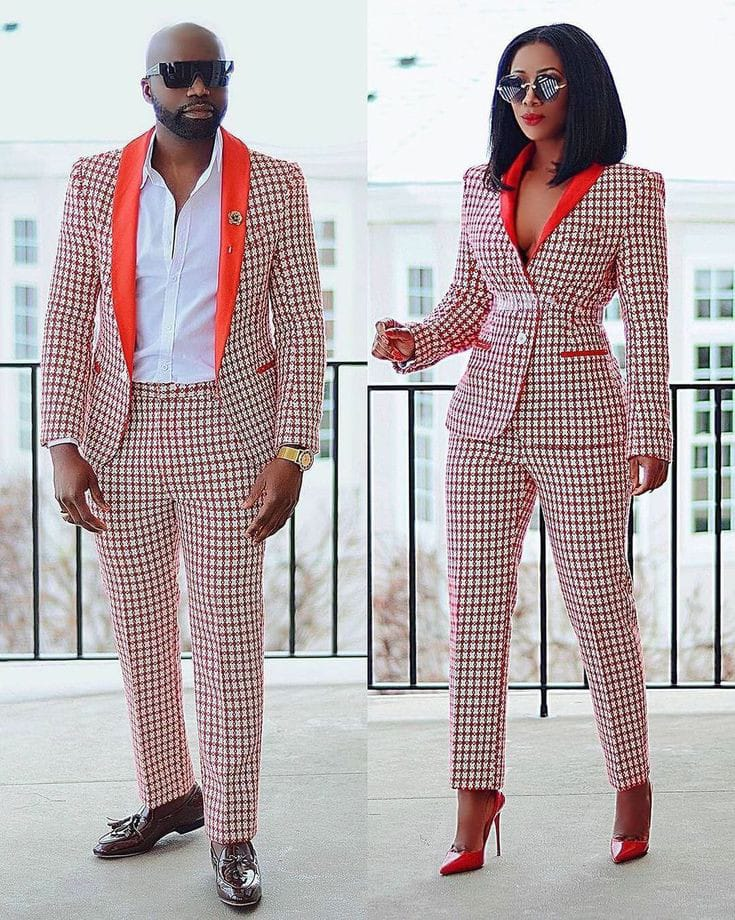 power couple wearing orange matching suits