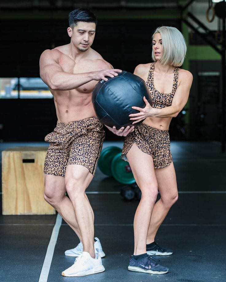 couple wearing active wear to exercise