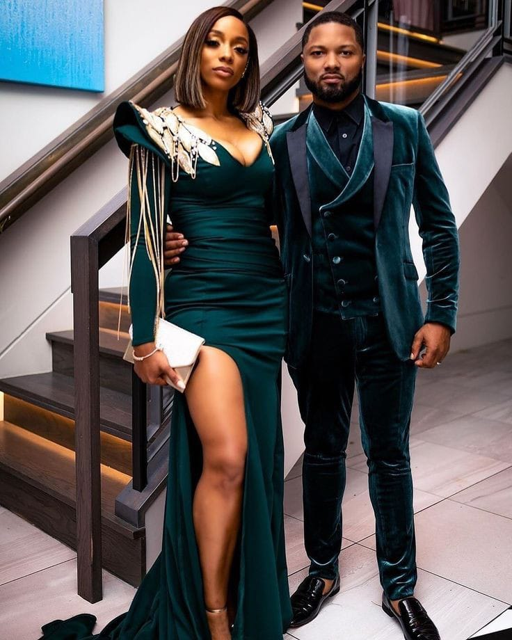 beautiful couple wearing green dinner outfit