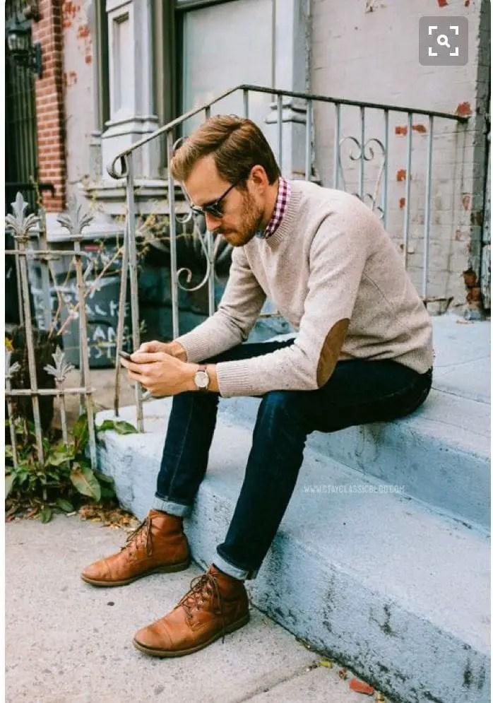man wearing black cuff jeans
