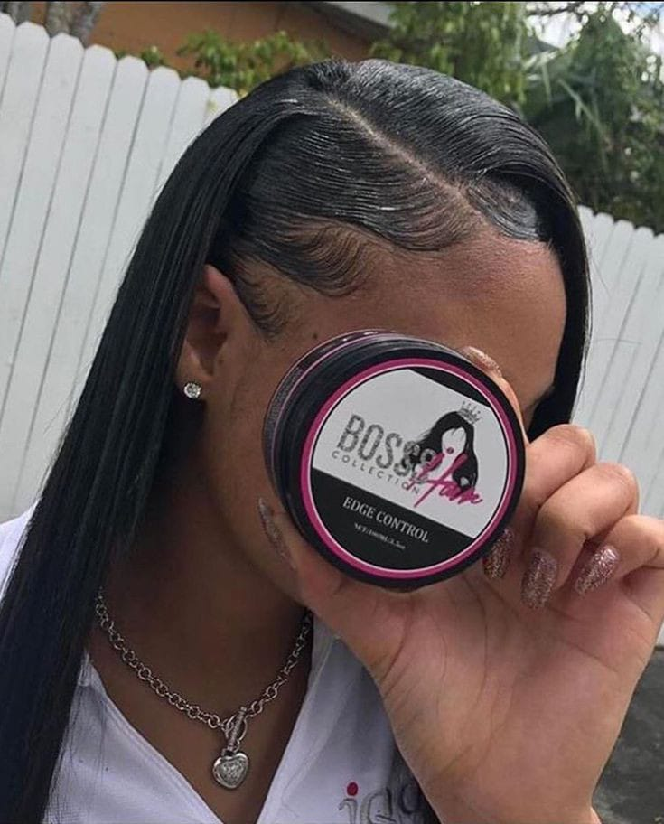 lady showing off her edge control product