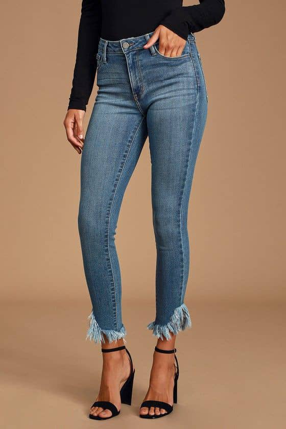 lady wearing frayed jeans with black heels