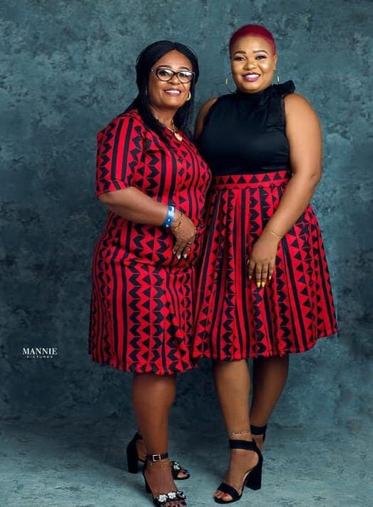 mother and grown daughter wearing matching outfit