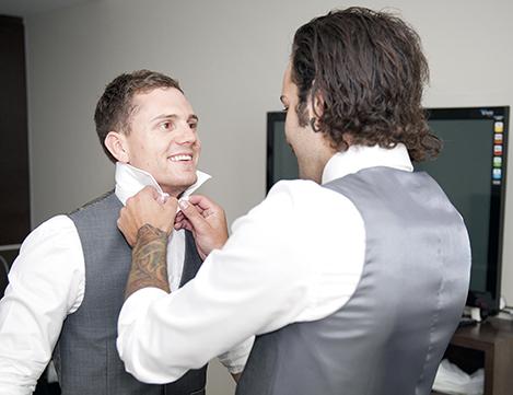 Best man adjusting tie