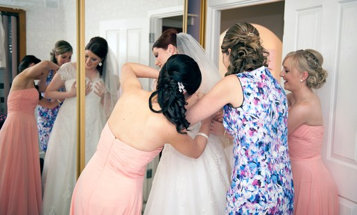 Putting the bridal dress on