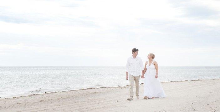 Bride and Groom Walking along Grange Beach