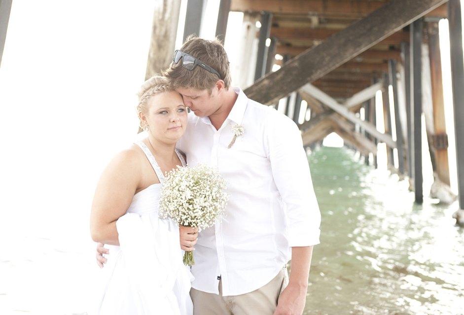 Bride and Groom under Grange Jetty