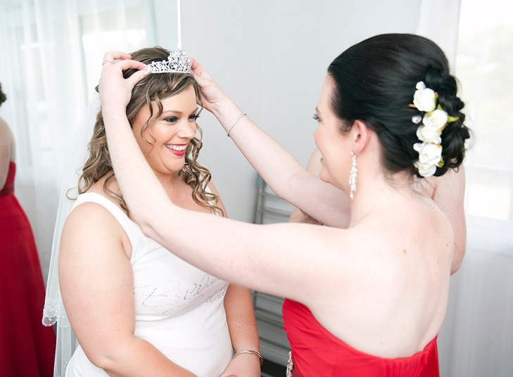 Putting on the bridal tiara