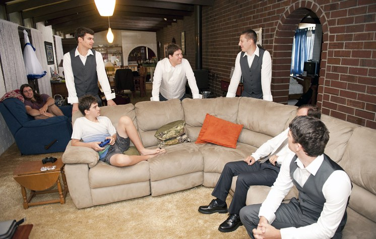 Groomsmen lunging about