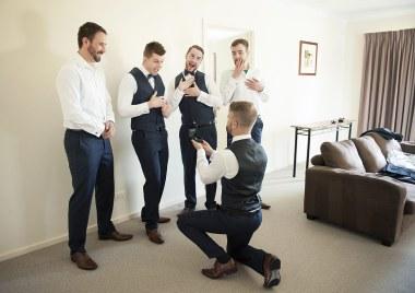 Groom proposing to groomsmen