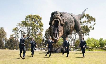 Groomsmen with dinosaur