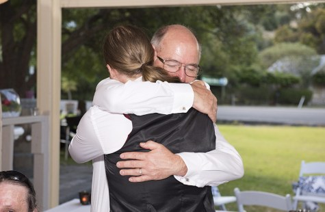 Groom and Father hugging