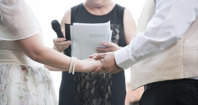 Bride and groom holing hands