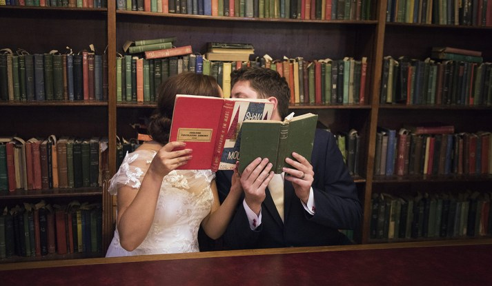 Bride and groom reading together