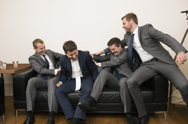 Grooms men playing about