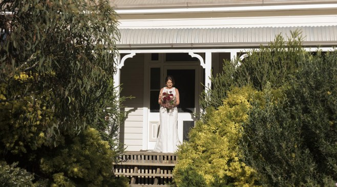 Bride standing out front