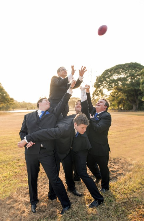Groomsmen playing marksup