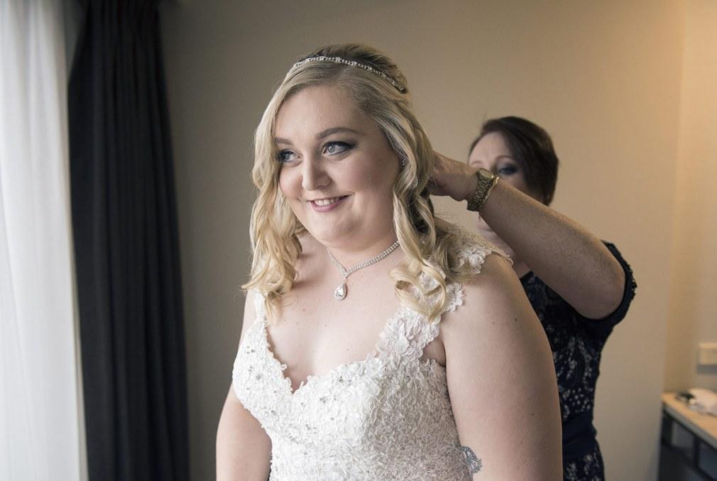 Putting on Wedding Dress