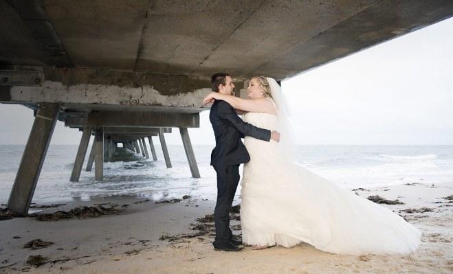 Bride and Groom under Glenelg Pier in Rain