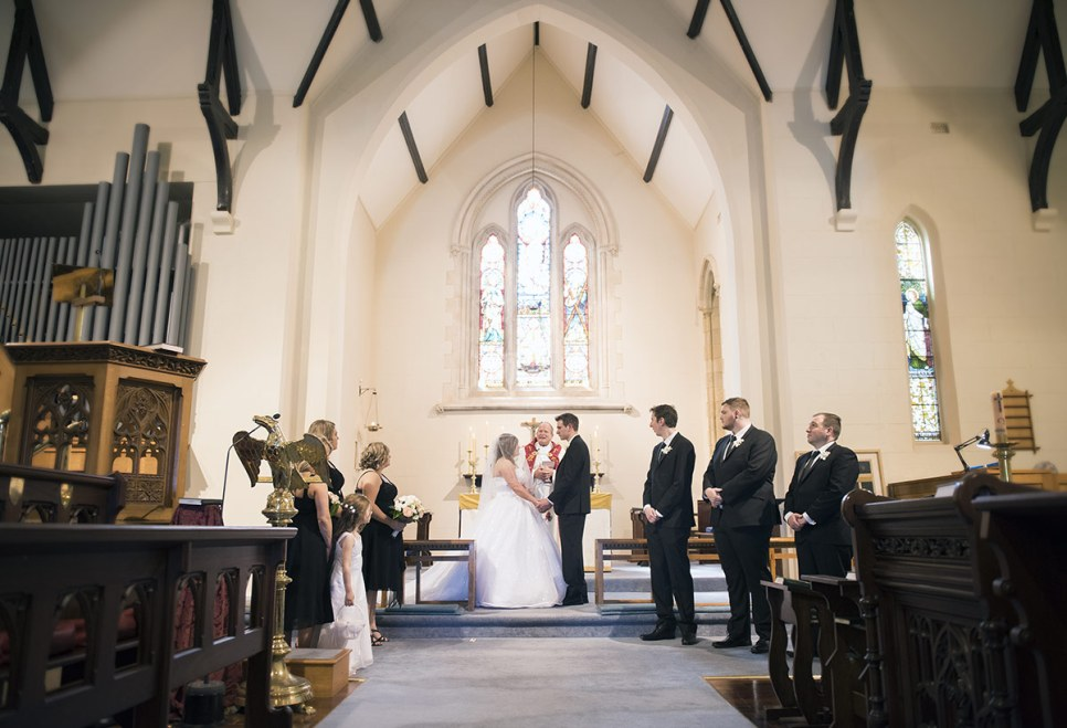 Bride and Groom at altar