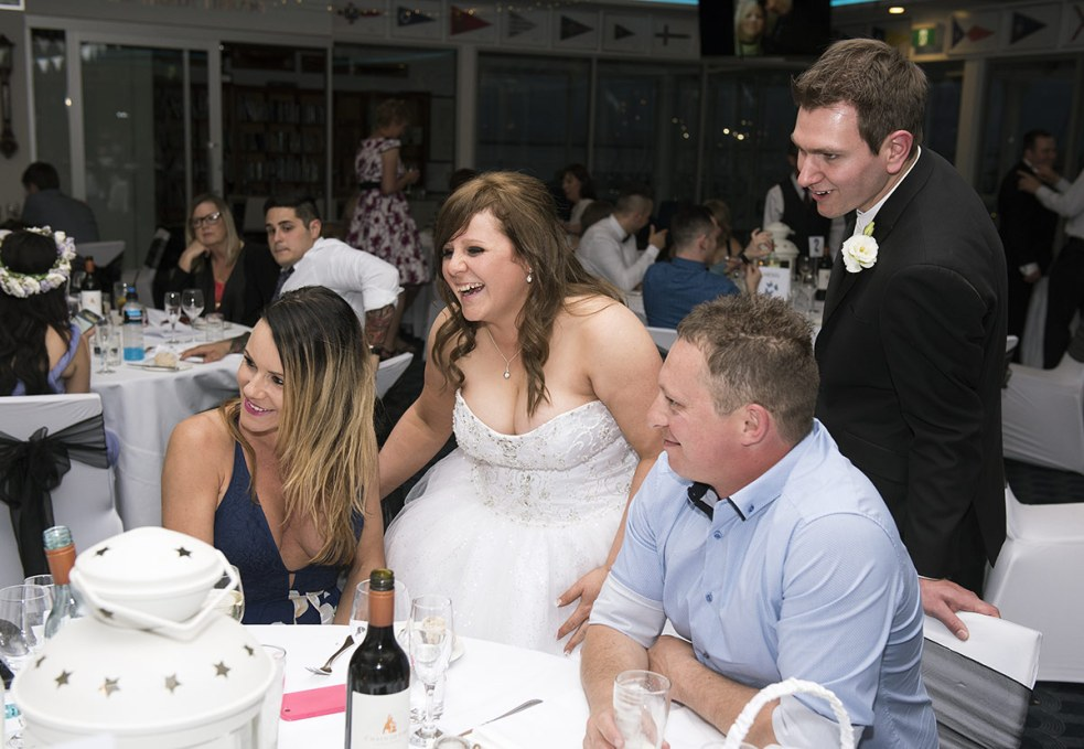 Bride and Groom laughing with guests