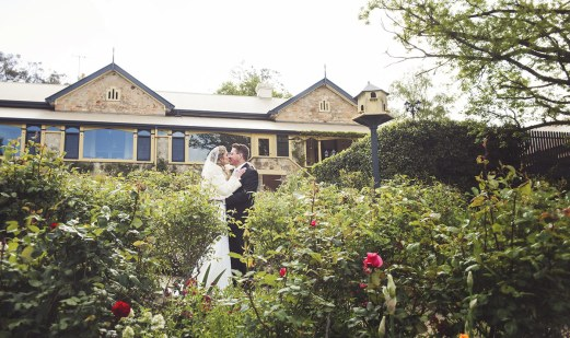Bride and Groom in front of Mt Lofty House