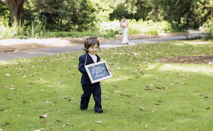 Page boy with sign