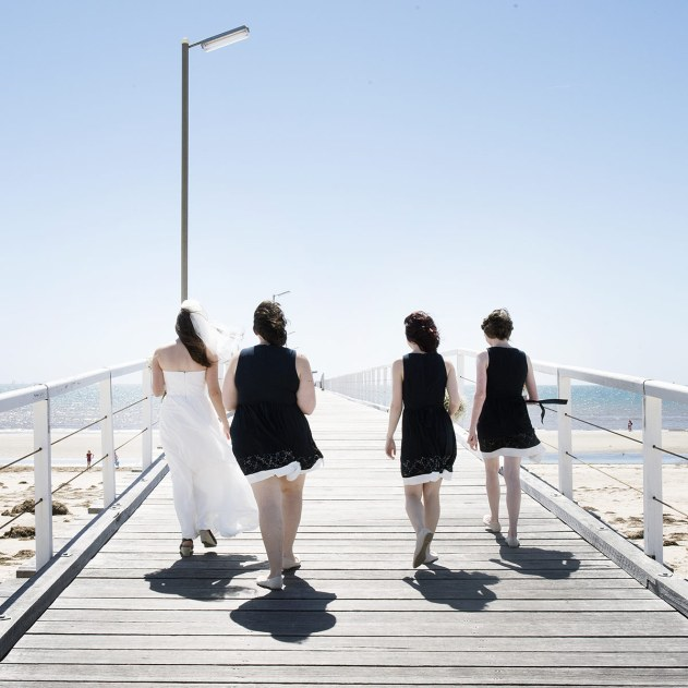 Bridal Party walking the pier
