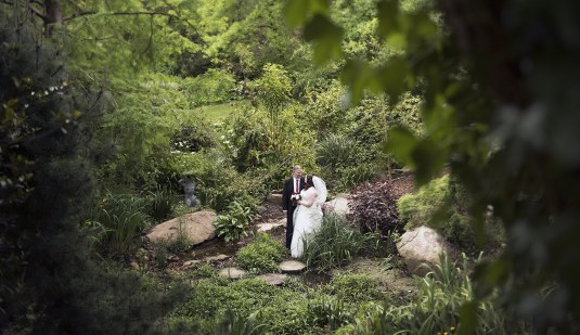 Bride and groom in crafers cottages garden