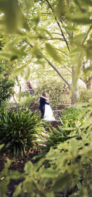 Bride and groom in wilderness